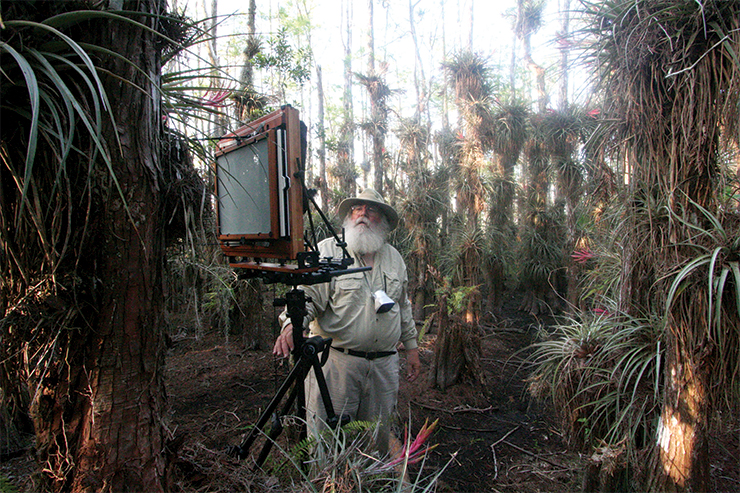 Technically speaking Known for his large, mural-sized images, Butcher is photographed here with his 11-by-14-foot view camera in Everglades National Park. Butcher works out of a 2,000-square-foot dark room.