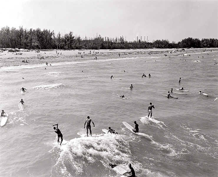 Catch a wave Local surfing has had a great history. Here, a group of surfers ride the waves in Dania Beach, 1967.