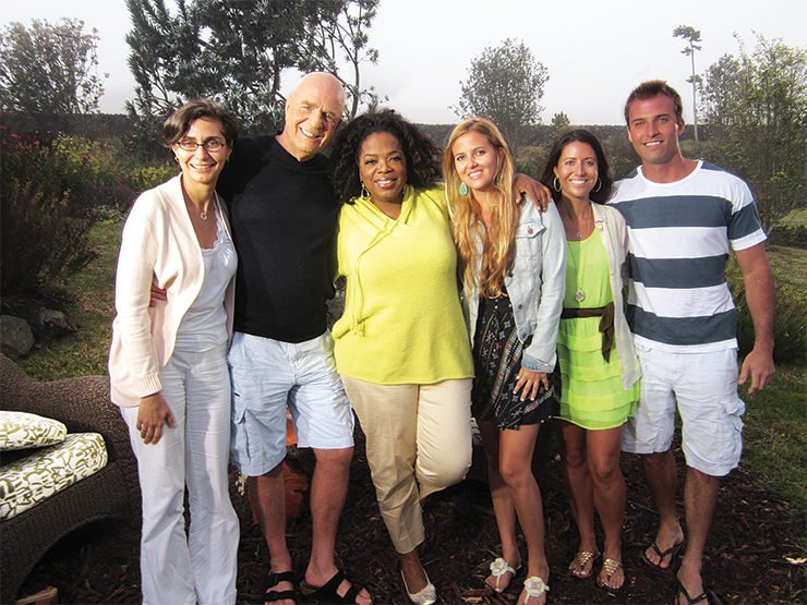Dyer's father, Dr. Wayne Dyer (second from left), is an internationally recognized author who counts Oprah Winfrey among his many readers.
