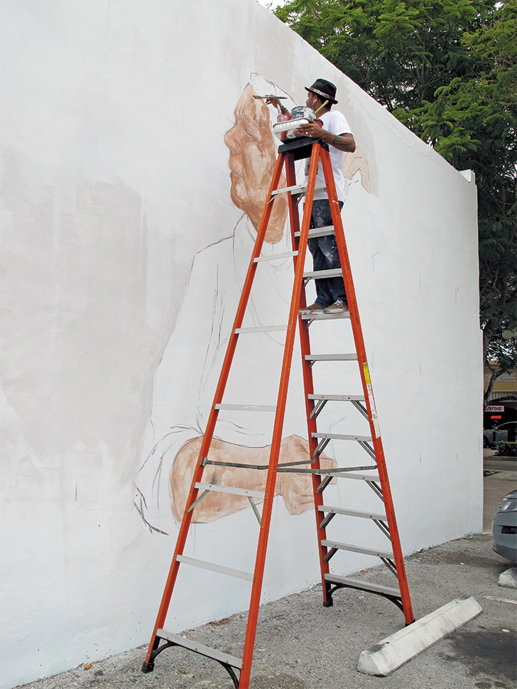 Dream Deferred Artist and humanitarian Evoca1 created a mural called Posers and Dream Crushers?at 2020 Hollywood Blvd.