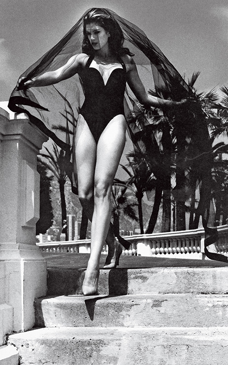 GO WITH THE FLOWMODEL CINDY CRAWFORD, WEARING ROBIN PICCONE IN MONACO, PHOTOGRAPHED BY HELMUT NEWTON, VOGUE, 1991.