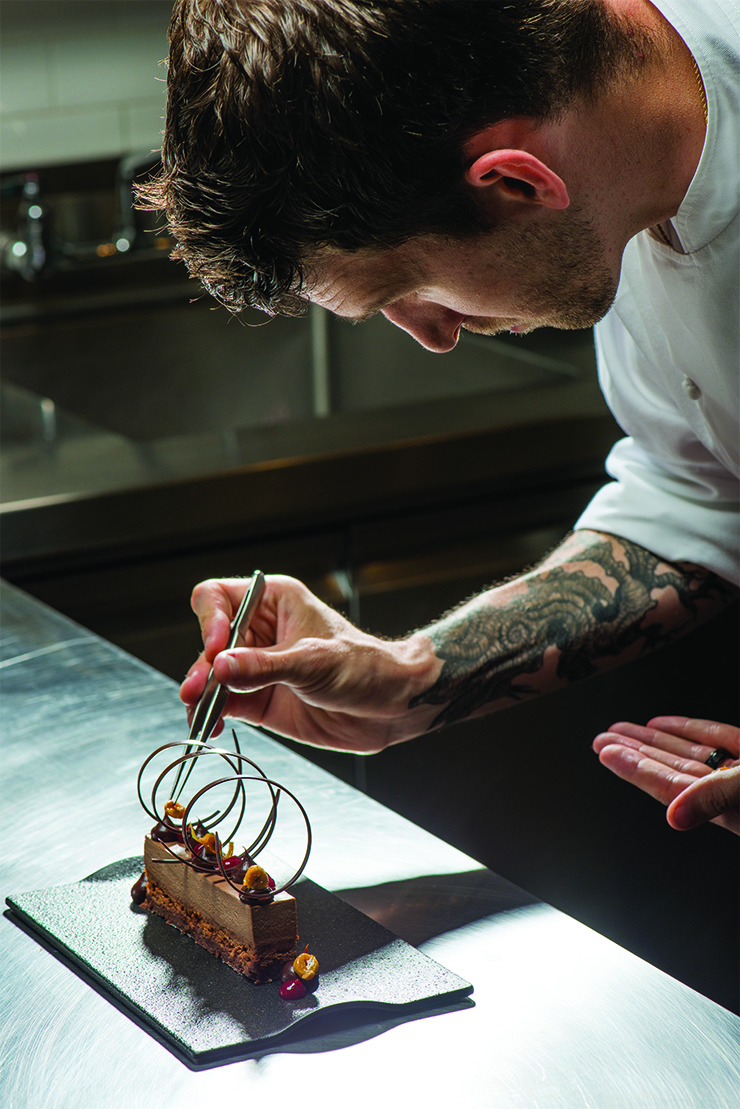 TWIST AND TURNS Recognizing the need to please the eye as well as the palate, Evans has a conscientious approach to the visuals of his dishes, including the popular chocolate hazelnut bar