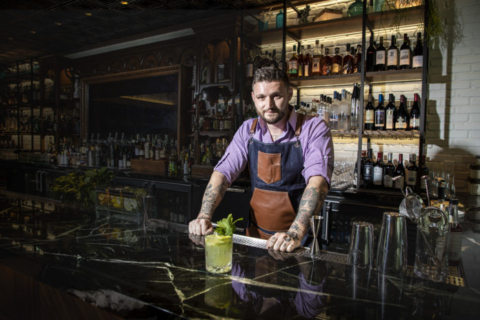 Bartender Dave Weisberg with Lionfish in Delray Beach.